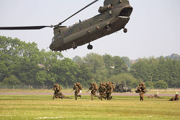 chinook helicopter airlifting troops - uk military stock photos and pictures