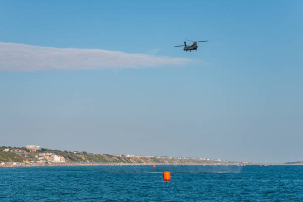 Chinook helicopter flies along Bournemouth coast stock photo
