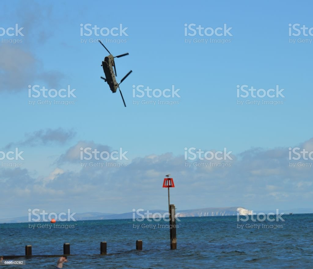 Chinook Helicopter nose dive to beach stock photo