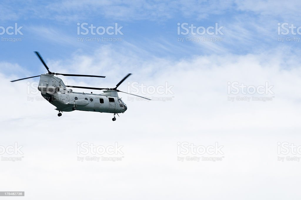 Chinook military helicopter in cloudy sky stock photo