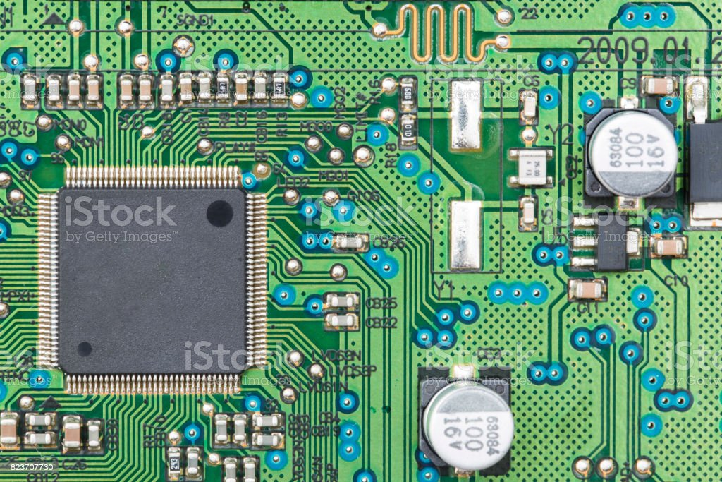Chip on a printed circuit board of green color stock photo