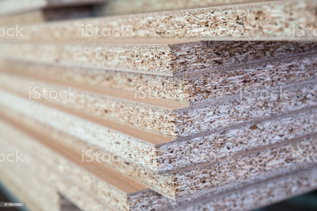 Chipboard pieces stacked in the workshop stock photo