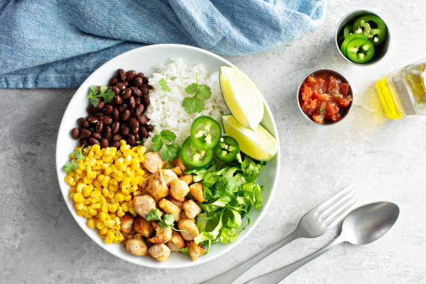 Chipotle spicy chicken with rice corn, beans stock photo