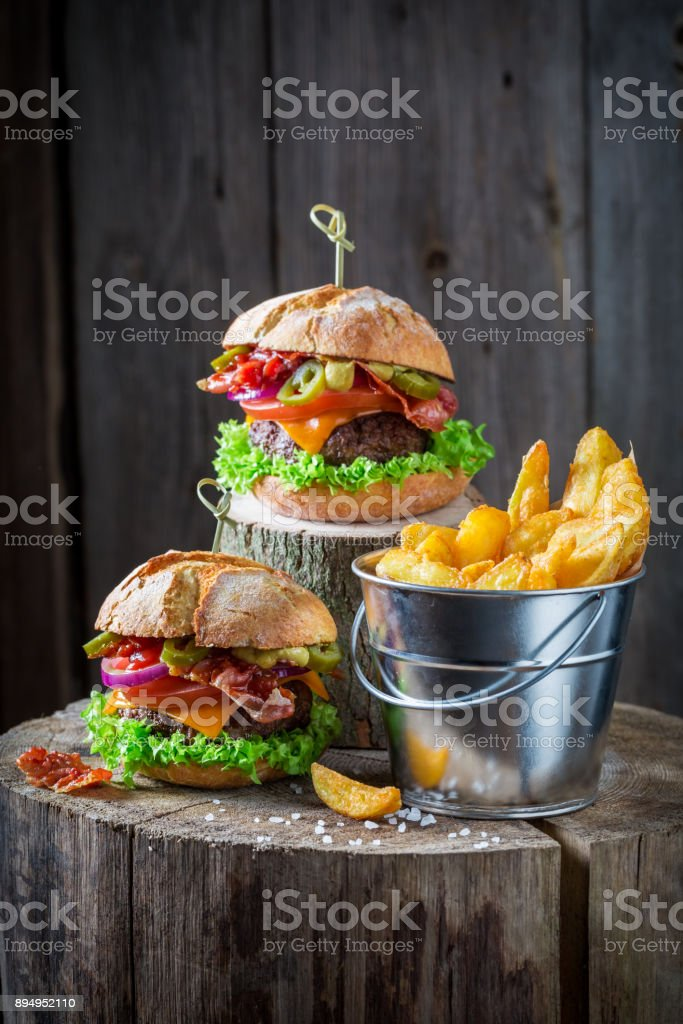 Chips and burger with lettuce, beef and cheese stock photo
