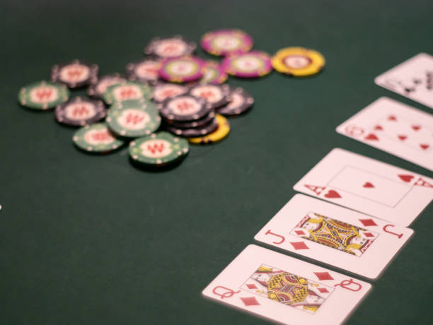 Chips and cards for poker on green table, cash game tournament – zdjęcie