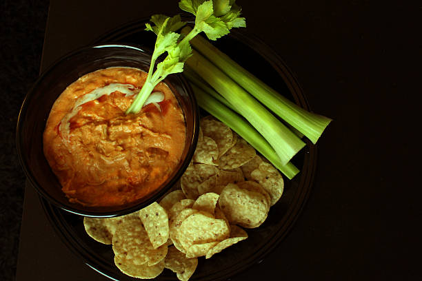 Chips and Dip Delicious buffalo chicken dip with celery and tortilla chips dipping sauce stock pictures, royalty-free photos & images