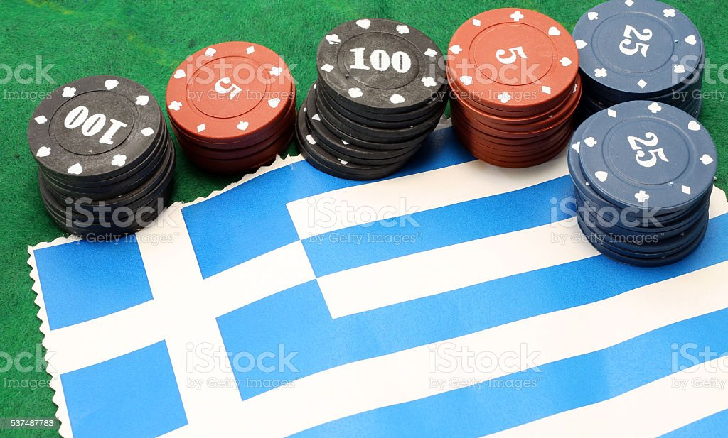 chips for gambling over the flag of Greece stock photo