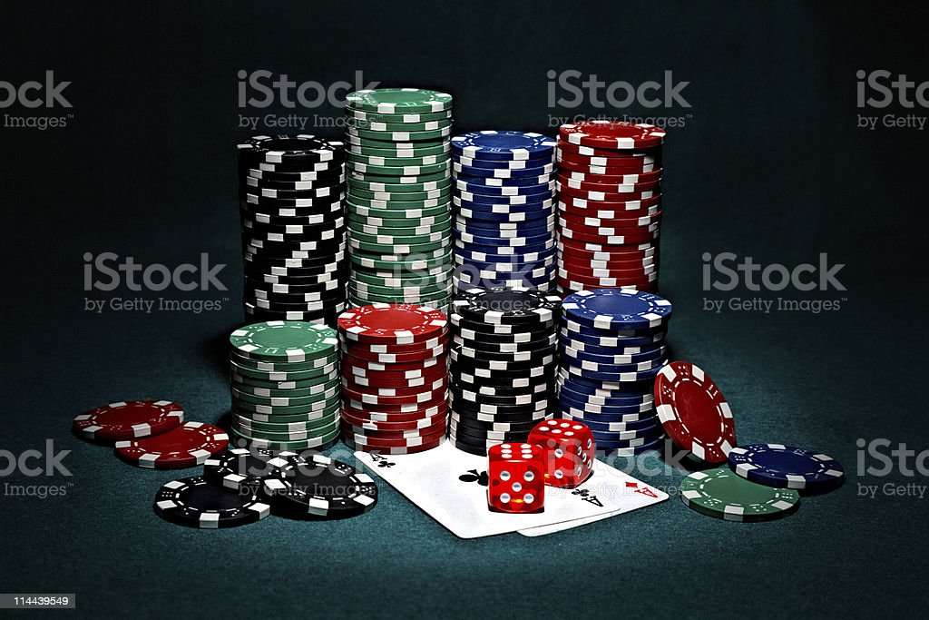 chips for poker with pair of aces and dice stock photo