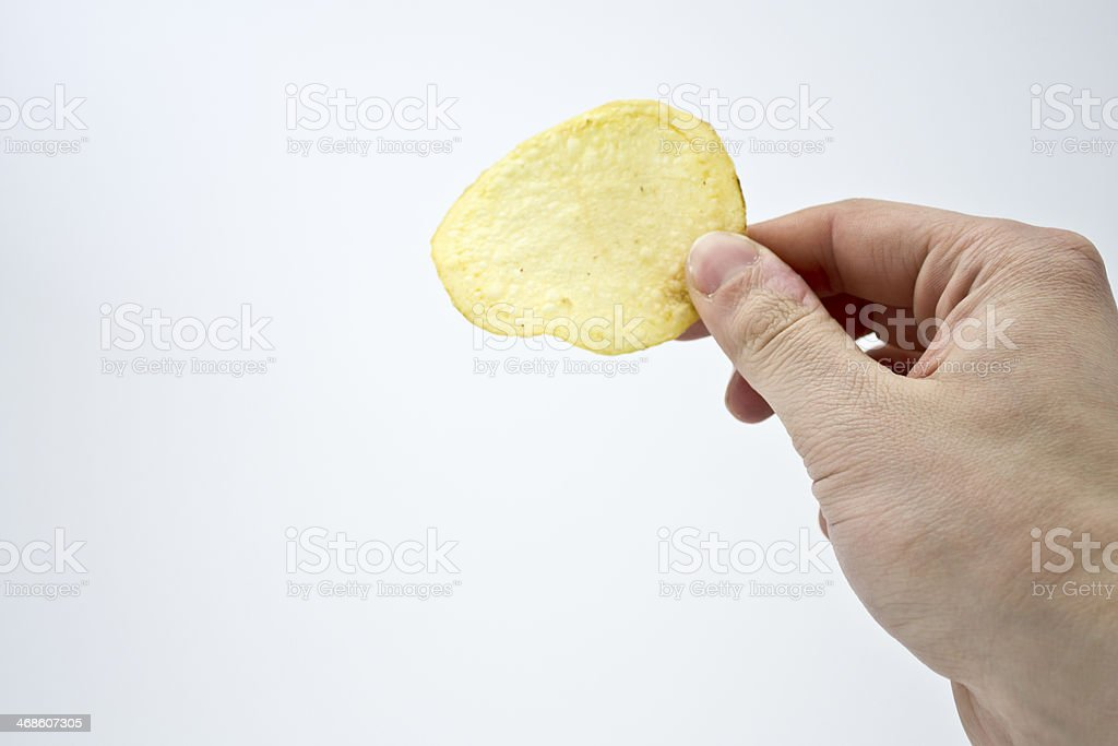 chips in the hand stock photo