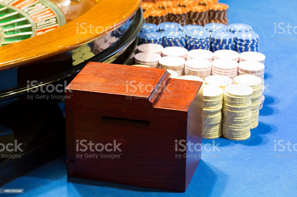 Chips on roulette table at casino stock photo