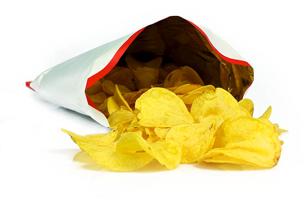 chips out bag - crisp packet stock photos and pictures