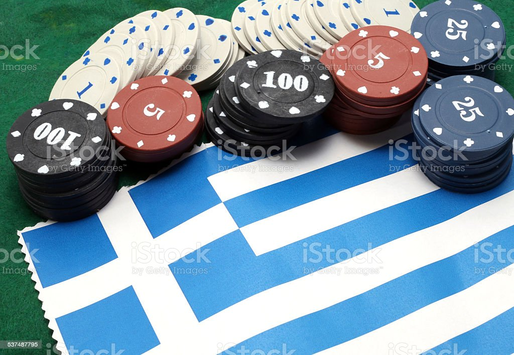 Chips tokens for gambling over the flag of Greece stock photo