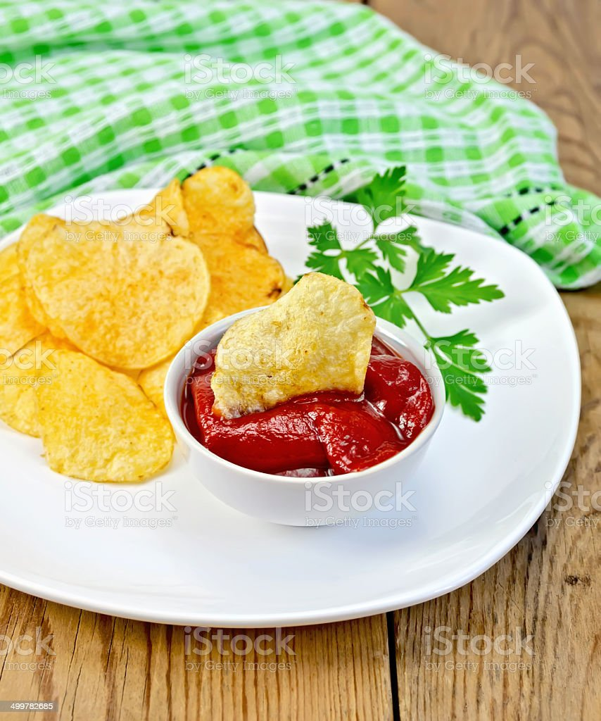 Chips with tomato sauce on the board royalty-free stock photo