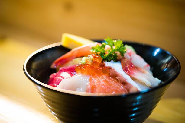 chirashi sushi, japanese food, rice bowl with mixed raw seafood - 丼物 ストックフォトと画像