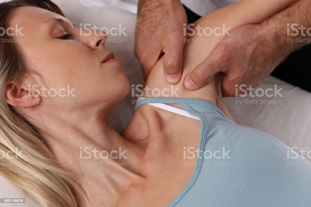 Chiropractic back adjustment. Osteopathy, Acupressure. Female patient suffering from back pain and physical therapist stock photo