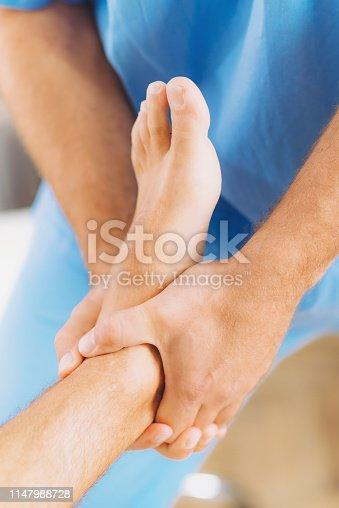 istock Chiropractic Foot Adjustment 1147988728