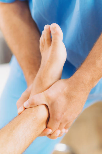 chiropractic foot adjustment - sports medicine stock pictures, royalty-free photos & images