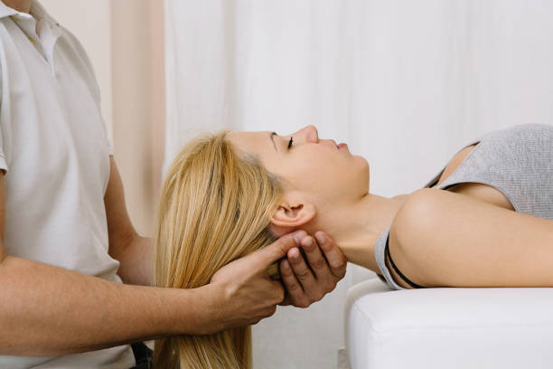 chiropractic neck adjustment - osteopathy stock pictures, royalty-free photos & images
