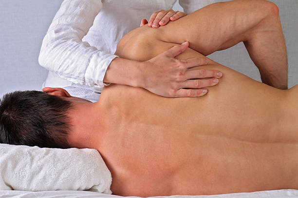 chiropractic, osteopathy, manual therapy. alternative medicine - chiropractic care stock photos and pictures