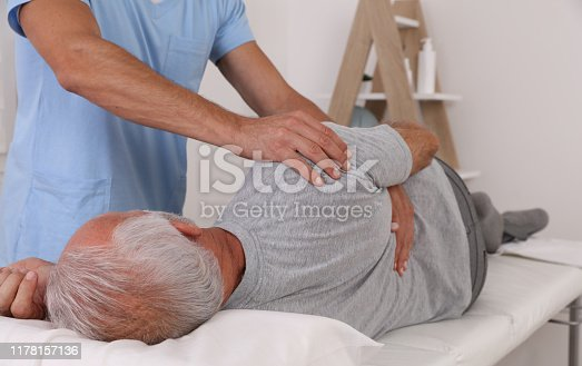 885281276istockphoto Chiropractic / Osteopathy treatment, Back pain relief. Physiotherapy for senior male patient, sport injury recovery , Kinesiology 1178157136