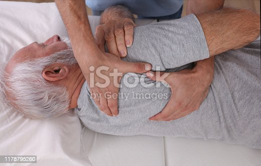885281276istockphoto Chiropractic / Osteopathy treatment, Back pain relief. Physiotherapy for senior male patient, sport injury recovery , Kinesiology 1178795260