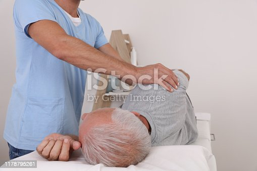 885281276istockphoto Chiropractic / Osteopathy treatment, Back pain relief. Physiotherapy for senior male patient, sport injury recovery , Kinesiology 1178795261