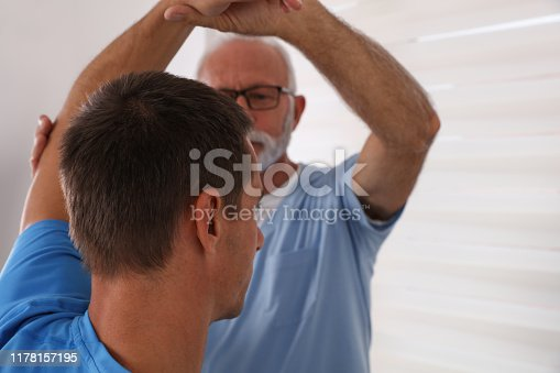 863158416istockphoto Chiropractic / Osteopathy treatment, elbow jont pain. Physiotherapy for male patient, sport injury recovery , Kinesiology 1178157195