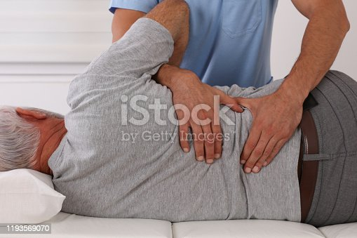 885281276 istock photo Chiropractic treatment, Back pain relief. Physiotherapy for senior male patient, Kinesiology 1193569070