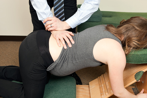 istock Chiropractor Adjusting Pregnant Woman's Back 185317447