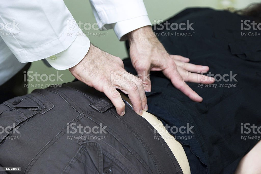 Chiropractor Adjusting Spine royalty-free stock photo