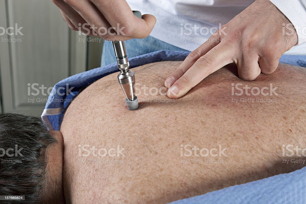 Chiropractor at work stock photo