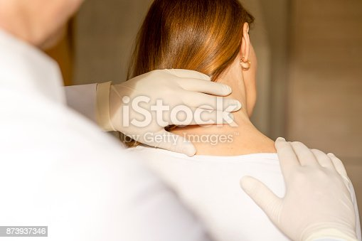 609830806 istock photo Chiropractor doing adjustment on female patient due to neck pain 873937346