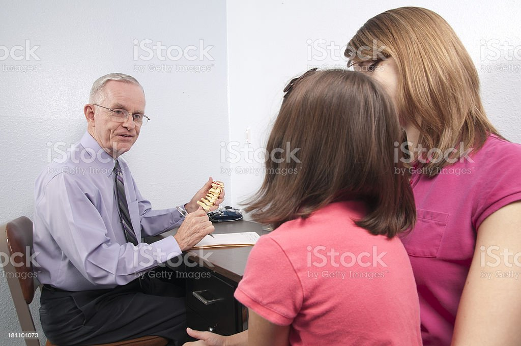 Chiropractor Explains Spine to Child and Mom royalty-free stock photo