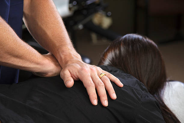 chiropractor patient - chiropractic care stock photos and pictures