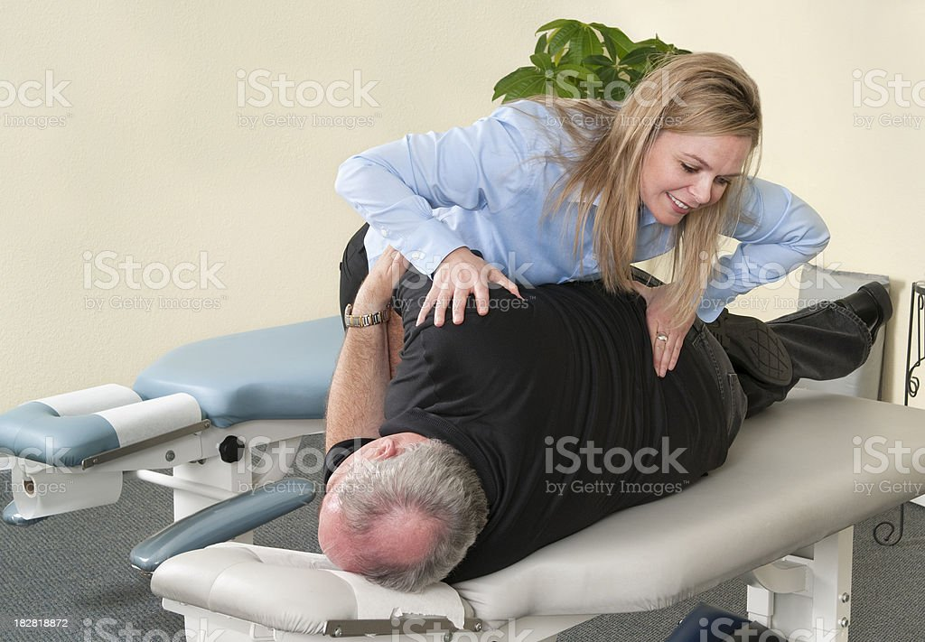 Chiropractor Treating a Man's Back royalty-free stock photo