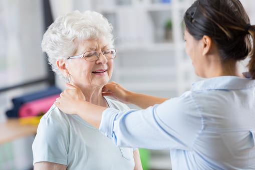950649706 istock photo Chiropractor works on senior woman's neck 846633142