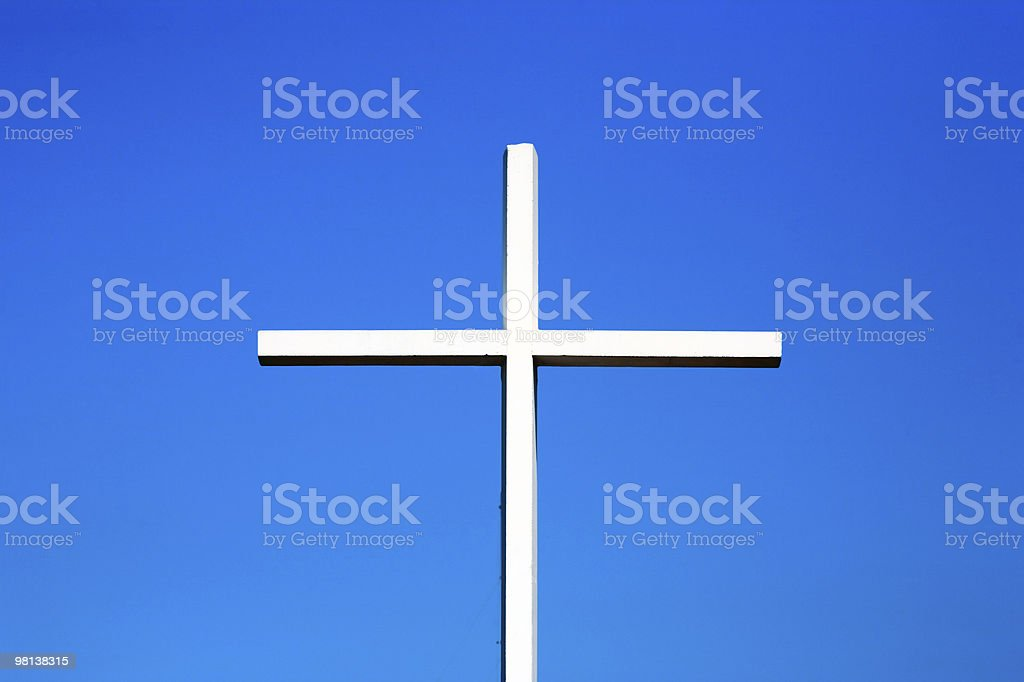 chirstian cross on blue sky royalty-free stock photo