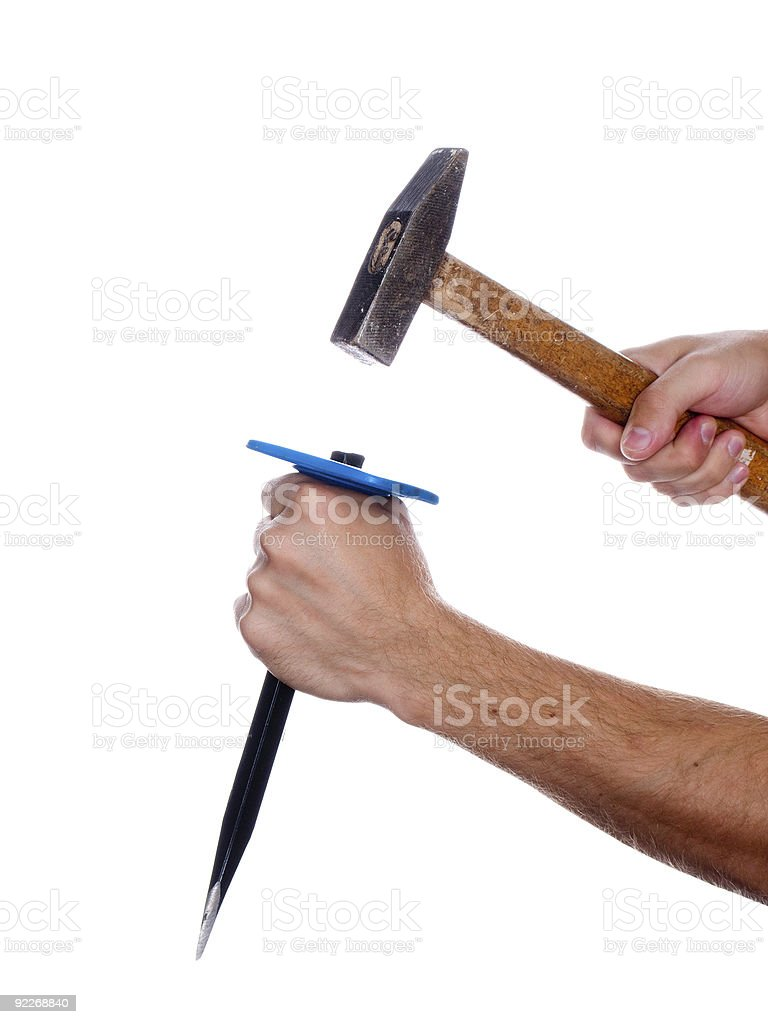 Chisel and hammer in hand stock photo