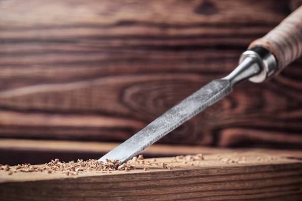 chisel cut groove in wooden pine plank. joinery, wood carving , carpenter's skill. - pillar drill stock photos and pictures