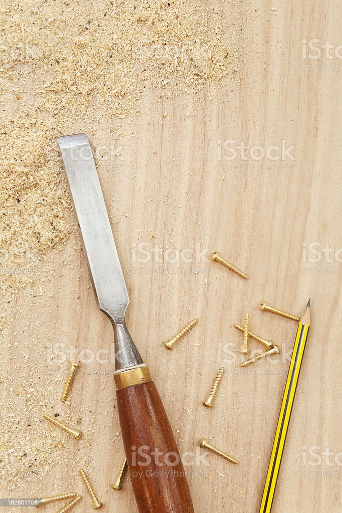 Chisel pencil screws and wood shavings royalty-free stock photo