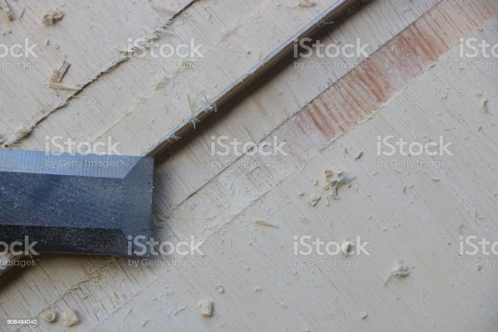 Chiseling a wood for making furniture stock photo