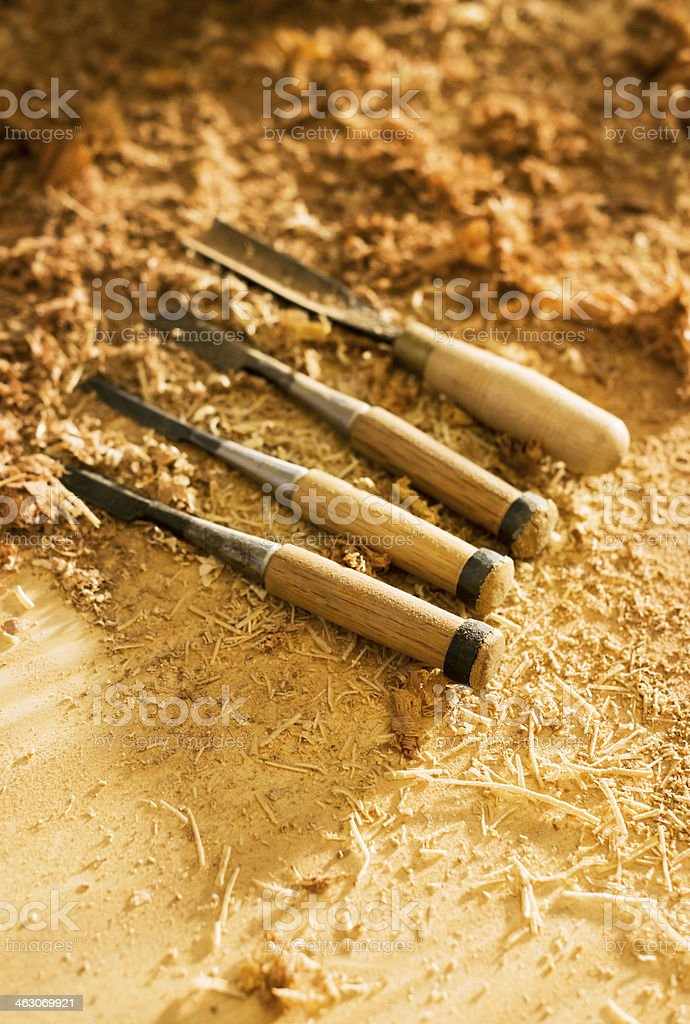 Chisels and Sawdust on Carpenter Table. Woodwork tools. royalty-free stock photo