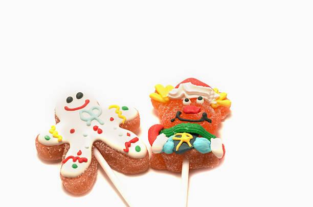 weihnachts lutscher auf weißem hintergrund - lutscher cookies stock-fotos und bilder