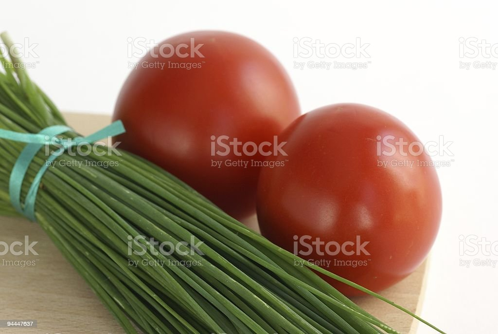 Chive and tomatoes royalty-free stock photo
