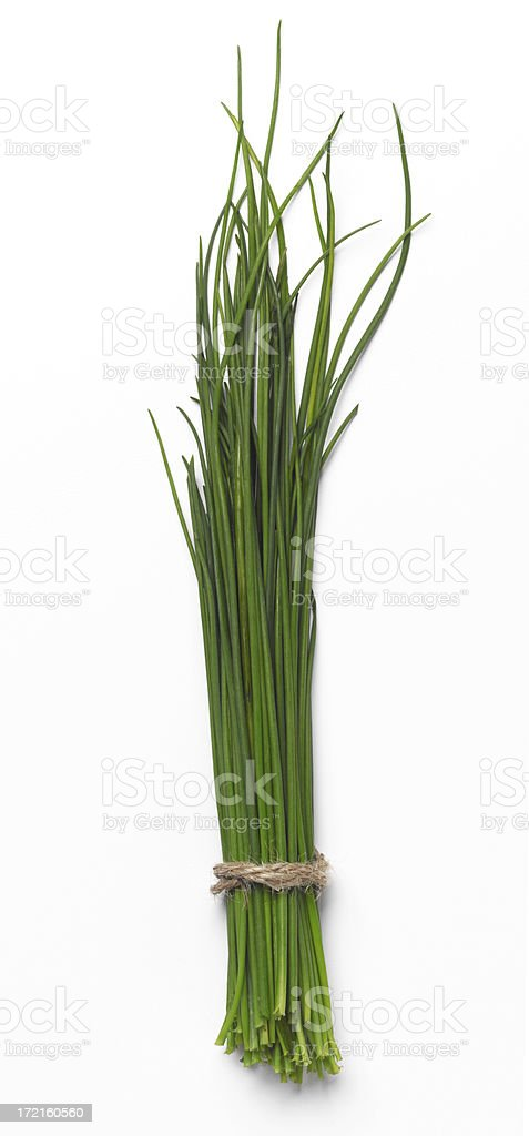 Chives wrapped in twine on a  white background stock photo