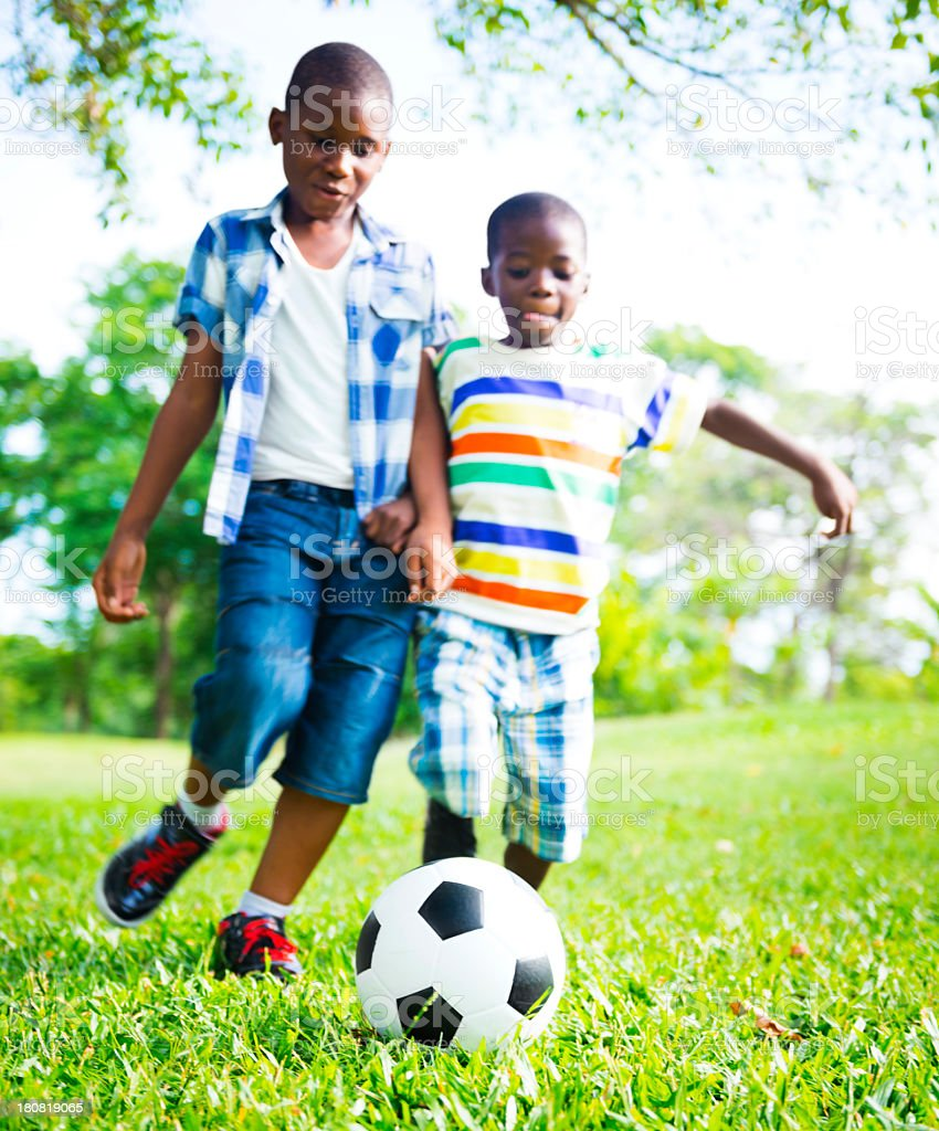 Chldren playing football Focus on the ball. royalty-free stock photo