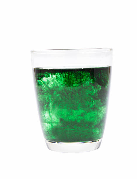 chlorophyll in glass isolated chlorophyll in glass isolated on white background chlorophyll stock pictures, royalty-free photos & images