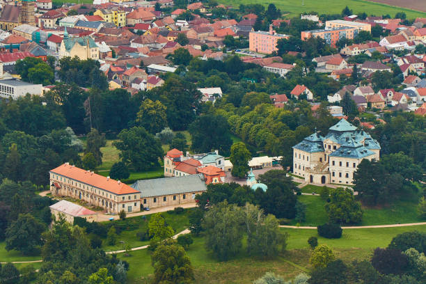 Chlumec nad Cidlinou, Czechia - 08/25/2019: Aerial photo of baroque castle Karlova Koruna surrounded by parks and trees and city in the background stock photo