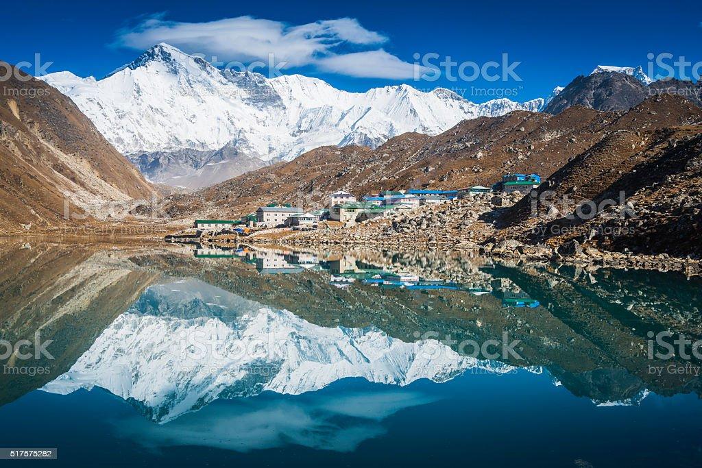 Cho Oyu 8201m snowy summit reflecting Gokyo Lake Himalayas Nepal stock photo