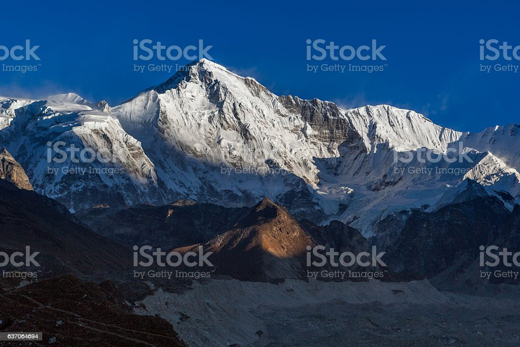 Cho Oyu mountain ridge lit up by the sun lights before stock photo